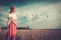 Beautiful hippie girl in a field Stock Photos