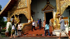 CHIANG MAI - March 2015: People visiting Wat Phra Singh. Speed up. - stock footage