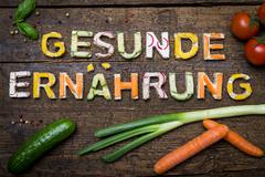 letters of vegetable canapes build the text gesunde ernährung - stock photo