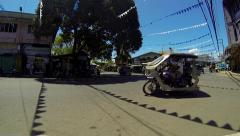 PUERTO PRINCESA - February 2015: Tricycles crossing junction. Stock Footage