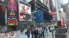 Tourist people visit Time Square New York City downtown city center landmark day Stock Footage
