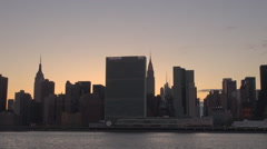 Panoramic New York City cityscape skyline twilight Empire State building tower  Stock Footage