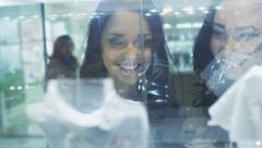 Two Girls Are Looking at Jewelry Shop Display Window. View through Glass. Stock Footage