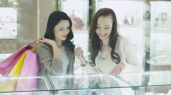 Two Girls in Jewelry Store are Watching at Display Windows - stock footage