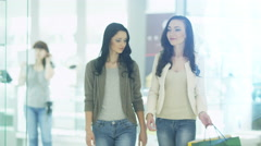 Two Girls are Showing their Purchases to Each Other - stock footage