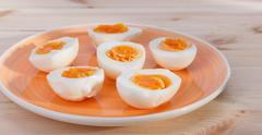 Hard-boiled eggs Stock Photos