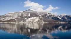 Lake with reflections of mountains near Mondsee, austria Stock Footage