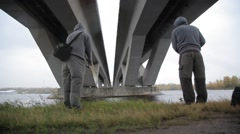Fishing under the bridge Stock Footage
