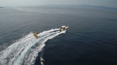 Aerial shot of water sport, tube rider on the sea - TWO CLIPS IN ONE! Stock Footage