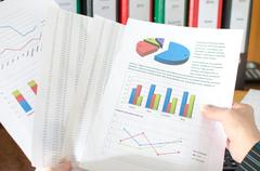 Female accountant checking financial documents - stock photo