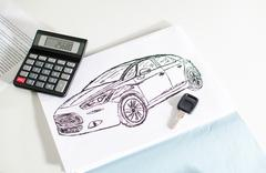 Car design, key and calculator - stock photo