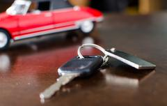 Car key on a wooden table - stock photo