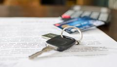 Car key, credit card on a signed sales contract Stock Photos