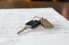 Car key on a signed sales contract Stock Photos