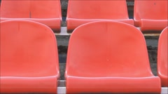 The camcorder is moving next to stadium chairs Stock Footage