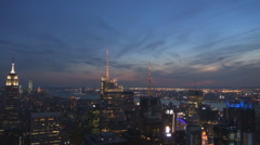 Aerial view Empire State building skyscraper tower New York City twilight USA US Stock Footage