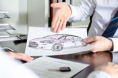 Dealer showing a car design - stock photo