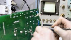 Check the signal using an oscilloscope - stock footage