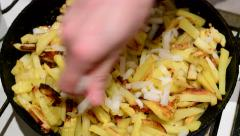 Fried potatoes sprinkled with onions Stock Footage