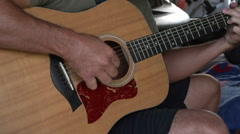 Man Playing Guitar in Shed Stock Footage