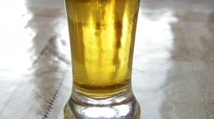Bubbles in a glass of beer Stock Footage