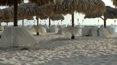 Aruba Eagle Beach 009 white tablecloths on tables for dinner on the beach Stock Footage