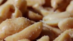 Close Up Shelled Salted Peanuts Tracking Shot Stock Footage