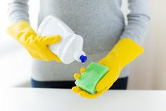 Close up of woman with sponge and cleanser Stock Photos