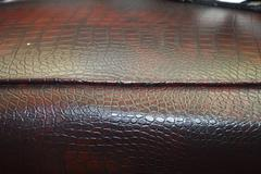Red dark leather seat upholstery Stock Photos