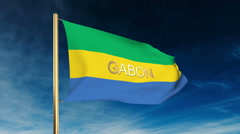 Gabon flag slider style with title. Waving in the wind with cloud background Stock Footage