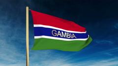 Gambia flag slider style with title. Waving in the wind with cloud background Stock Footage