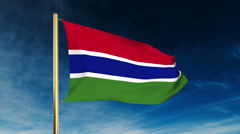 Gambia flag slider style. Waving in the wind with cloud background animation Stock Footage
