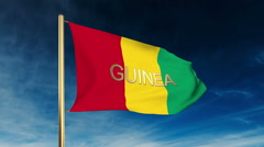 Guinea flag slider style with title. Waving in the wind with cloud background Stock Footage