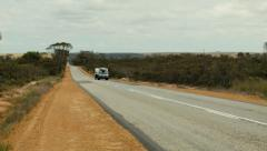 Car and Caravan Travelling Down An Australia Highway Arkistovideo