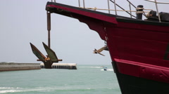 Ship with anchor, speed boat in background of the port Stock Footage