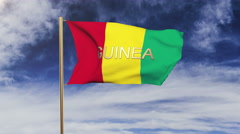 Guinea flag with title waving in the wind. Looping sun rises style.  Animation Stock Footage