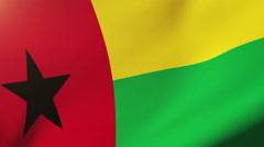 Guinea-Bissau flag waving in the wind. Looping sun rises style.  Animation loop Arkistovideo