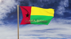 Guinea-Bissau flag with title waving in the wind. Looping sun rises style Stock Footage