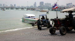 Speed boat tractors, pull out boat from sea, Pattaya Stock Footage
