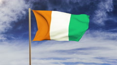 Ivory Coast flag waving in the wind. Green screen, alpha matte. Loopable Stock Footage