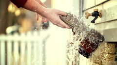 Slow motion washing the sole of a boot under tap HD - stock footage
