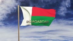 Madagascar flag with title waving in the wind. Looping sun rises style Arkistovideo
