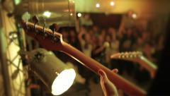 Guitar in live action at a concert with disco lights - stock footage