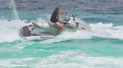 Speeding And Splashing On Jet Skis - stock footage