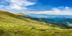 Stock Photo of valley on hillside of mountain range