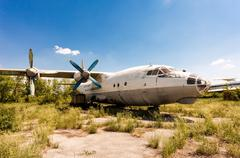 Turboprop aircraft An-12 at an abandoned aerodrome in Samara, Russia - stock photo