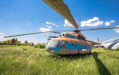 The russian transport helicopter Mi-6 at an abandoned aerodrome - stock photo