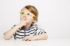 Young boy in yellow specs - stock photo