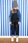 Girl in dungarees Stock Photos