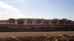 Row of giant dumper lorries Stock Footage